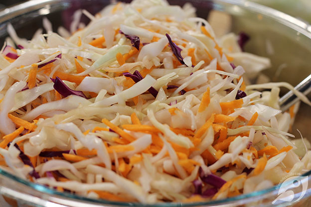 making Creamy Coleslaw green and purple cabbage with carrots