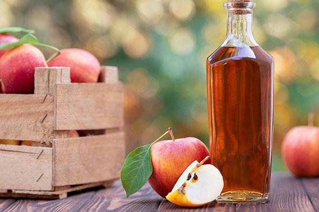 Gluten-Free Food: Apple Cider Vinegar Bottle with Apples