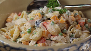 Gluten-Free Food: Seafood Pasta Salad in bowl closeup with spoon