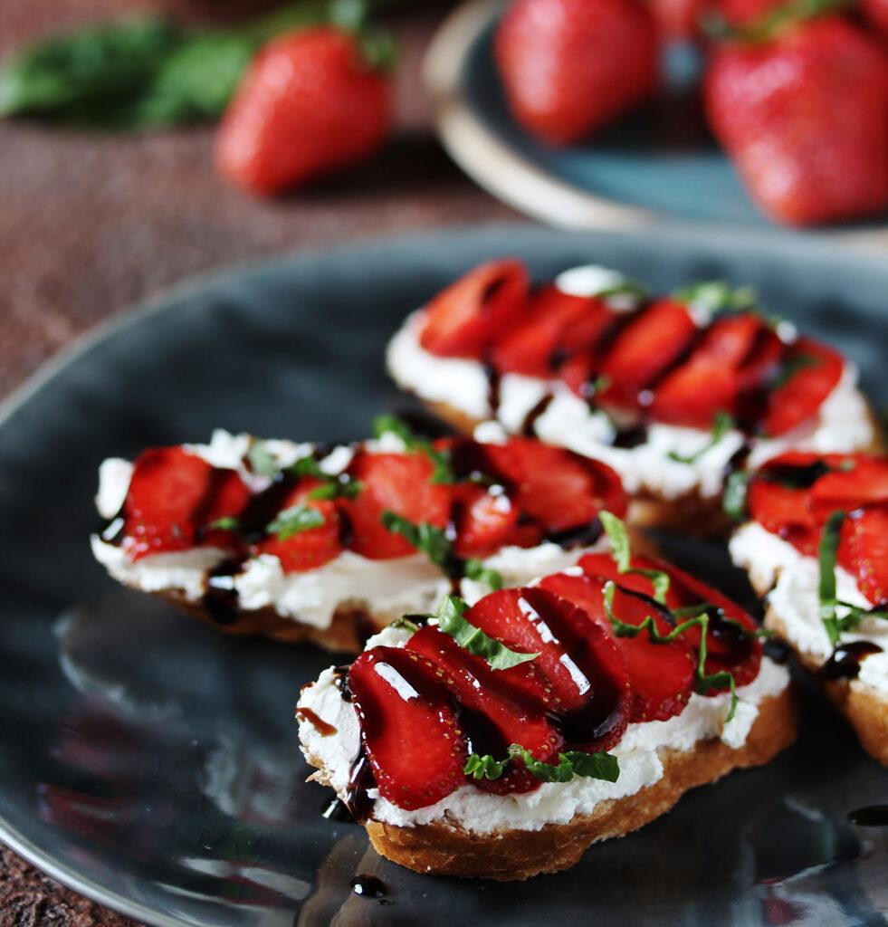 Strawberry Balsamic Vinegar with strawberries and balsamic drizzle on gluten-free bruchetta