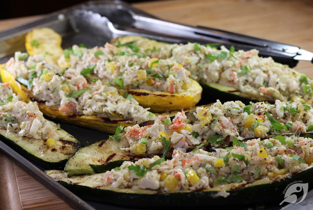 Crab-Stuffed Zucchini and Summer Squash Boats fresh from the grill on a tray.