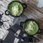 soup served in black cauldron soup bowls with halloween table setting