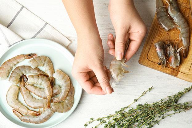 shrimp being peeled