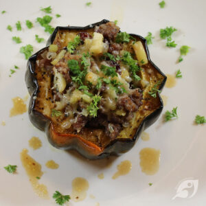 one serving (one half) stuffed acorn squash on a plate