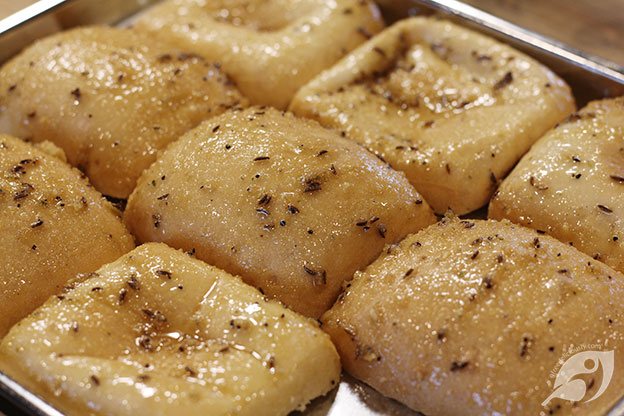 Warmed buns with Buttery Sauce made with carraway seeds, onion blend, garlic galore bend and other seasonings