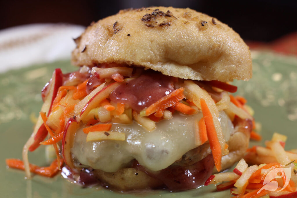 Closeup - Sage Turkey Slider with Apple Carrot Slaw & Cranberry Mayo on a plate