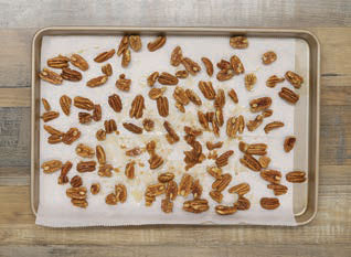 pecan halves arranged on a sheetpan to dry