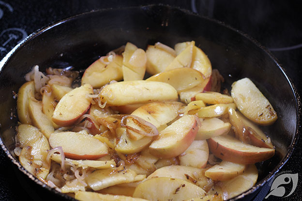 apples and shallots cooking in a cast iron skillet