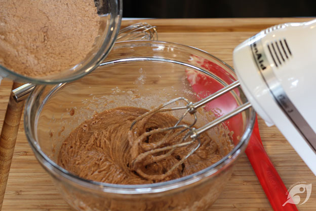 Add dry ingredients a little to a time.