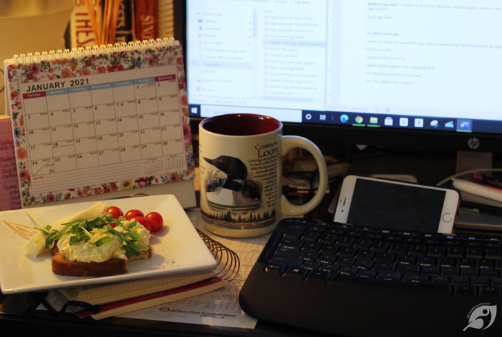 egg salad at my dest with computer monitor and keyboard in photo