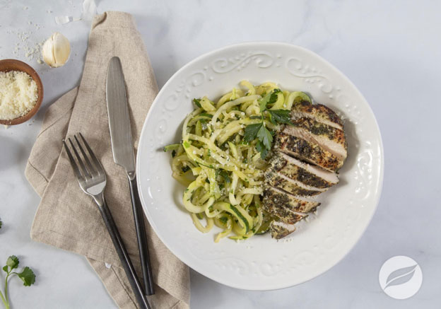 Lemon Garlic Butter Chicken & Zoodles plated with knife fork and napkin on the side of the dish