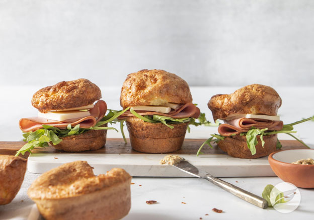 Ham & Cheddar Popover Sandwiches on cutting board
