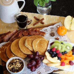 Gluten-Free Pancake Board (Breakfast Charcuterie Platter) with pancakes, fruit, granola, syrup