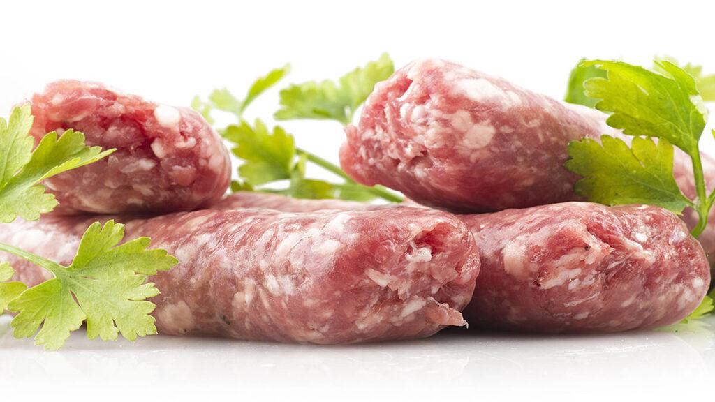Closeup of raw brat sausages.