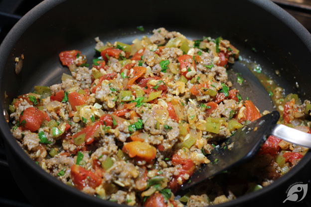 Mixed vegetables and tomatoes in the skillet with the liquid dried up.