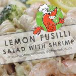 Lemon Fusilli Salad with Shrimp background with cartoon shrimp two thumbs up Pinterest sharing image 800x1200 px