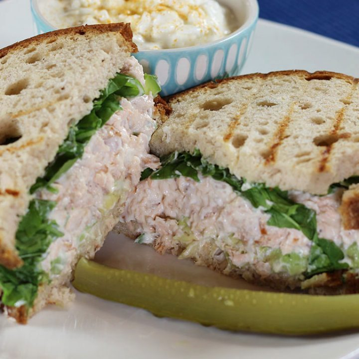 Ham Salad Sandwich Spread on a plate with pickle, cottage cheese in background