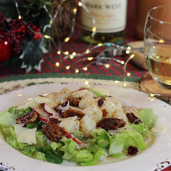 plate with lettuce greens, anjou Pear and seared sea scallops with candied pecans